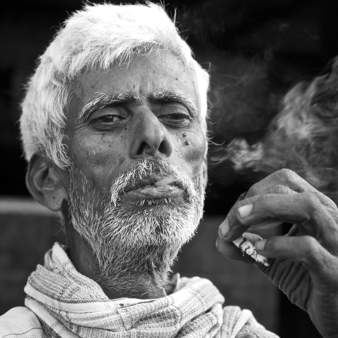 Old man smoking.
