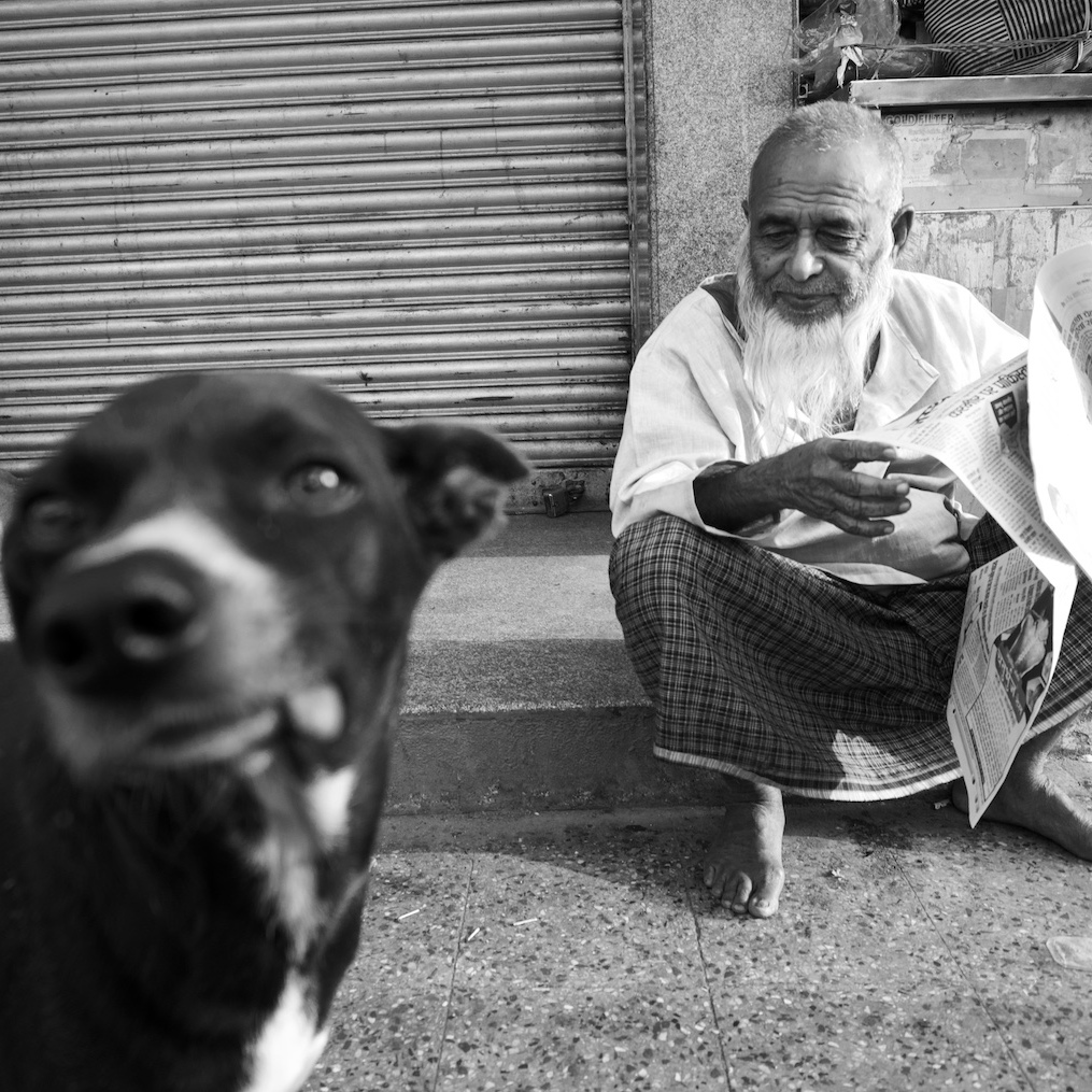 Dog and old man portrait.