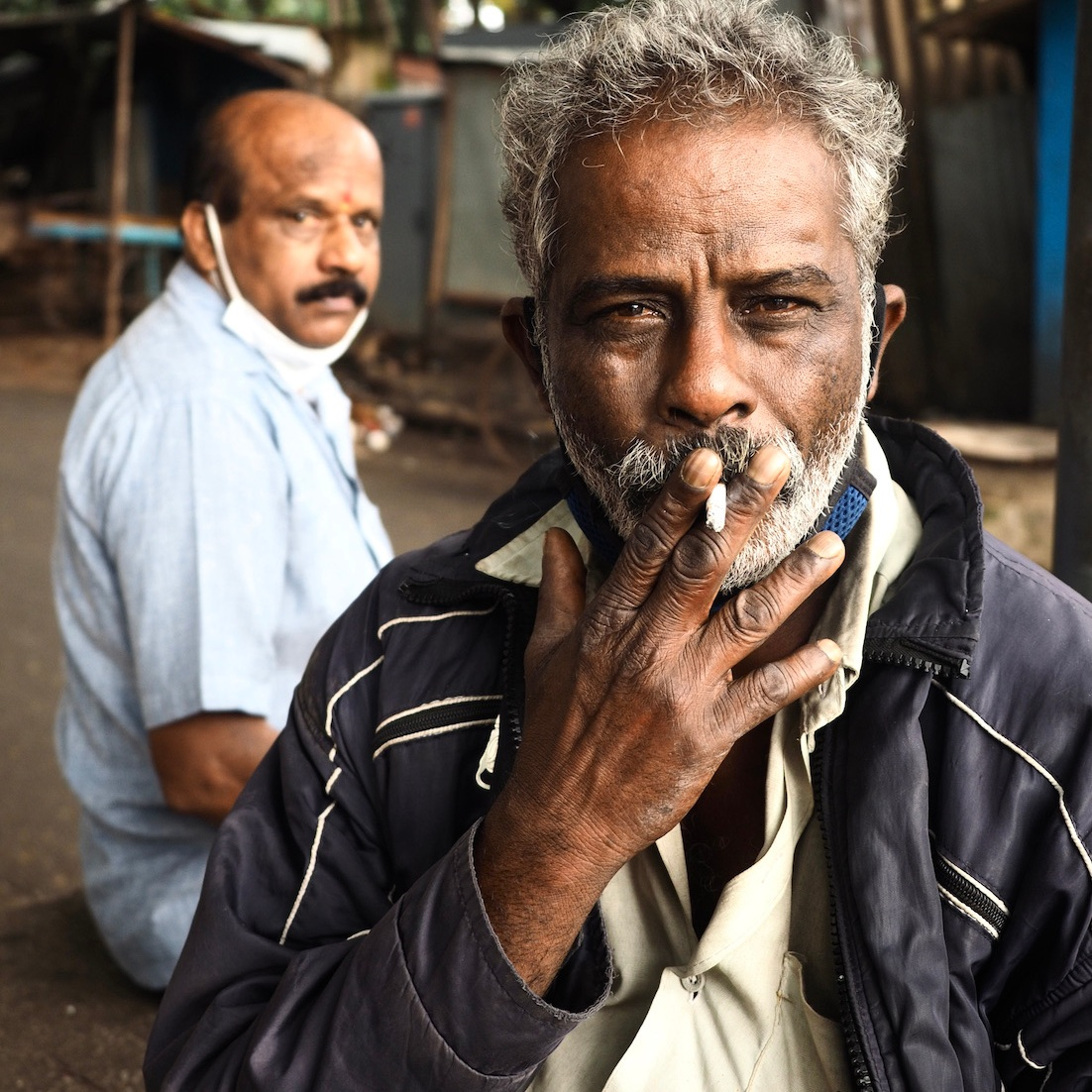 Man with cigarette in his hand.