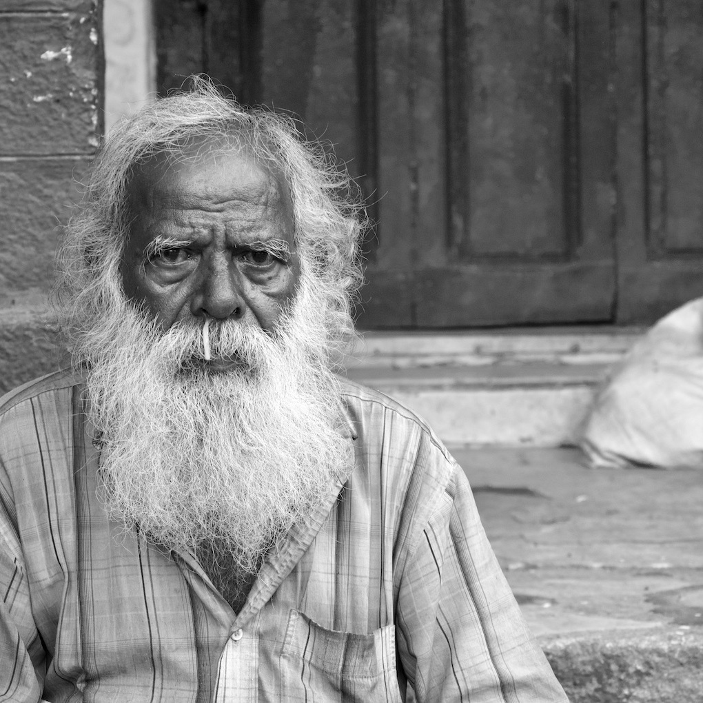 Old man with runny nose.