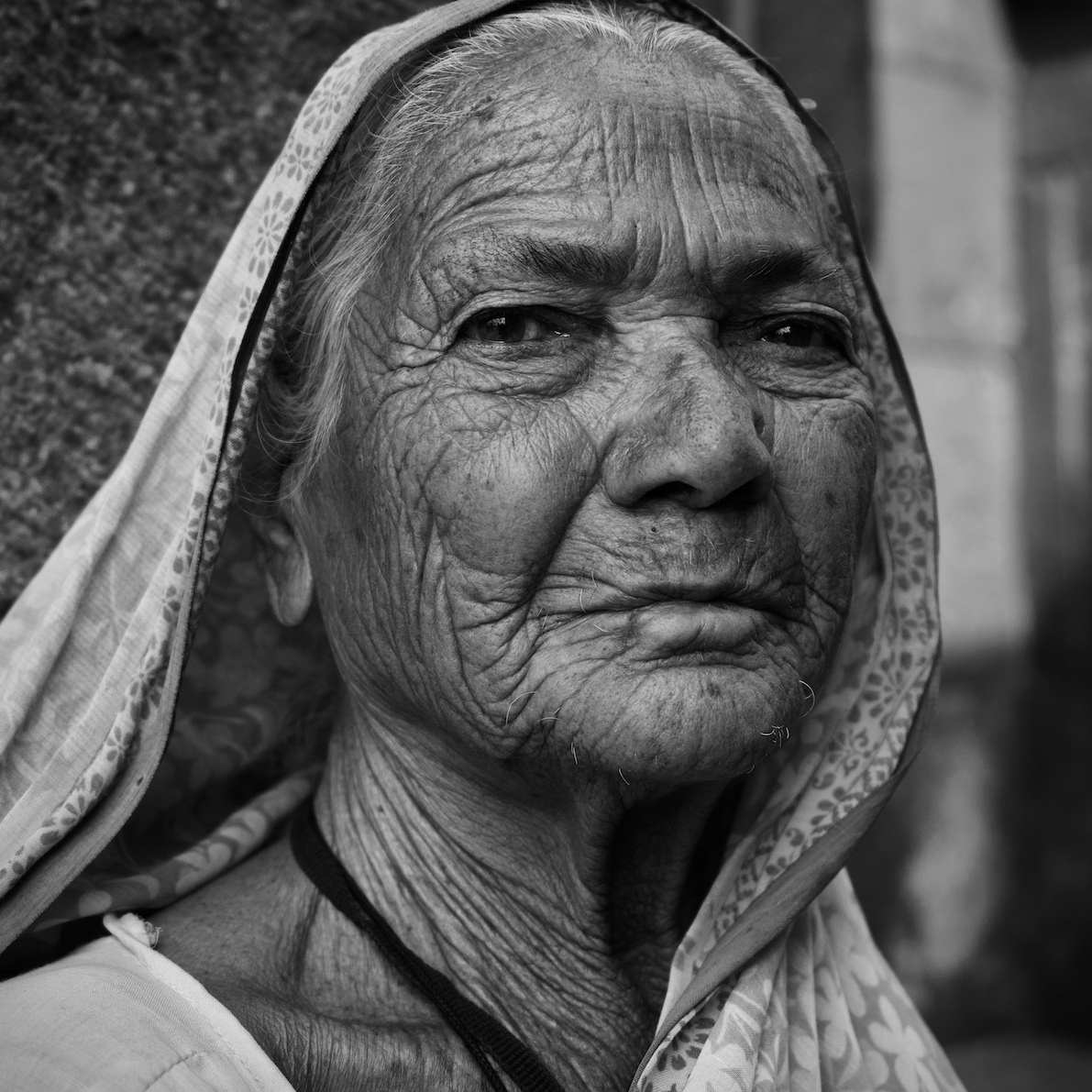 Old woman with wrinkled face.
