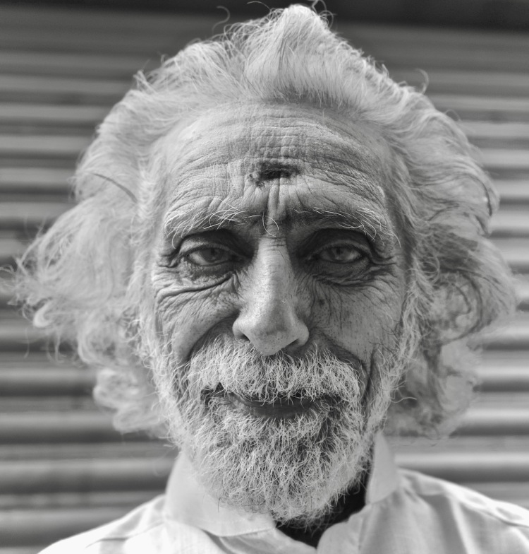 Indian old man with long white hair