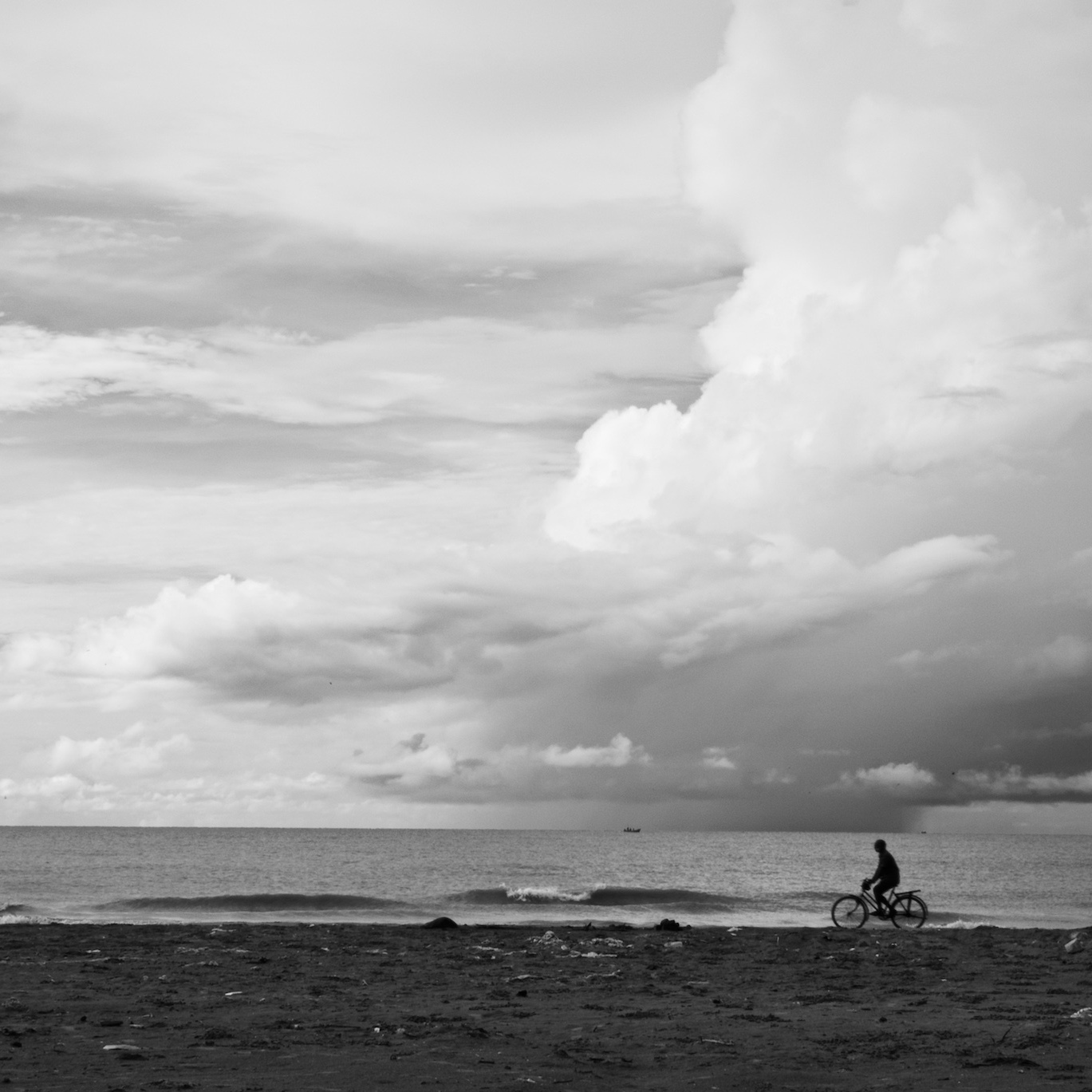 Man cycling by the beach